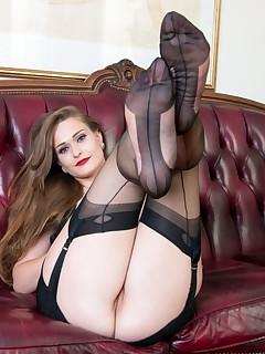 luscious girl shows her pretty feet in nylon stockings